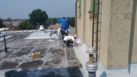 Upper Darby PA - Applying Roof fabric with Polarhide from Roof to parapet wall