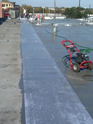 Polarhide Epoxy Roof- Fabric being embedded- ModBit Roof