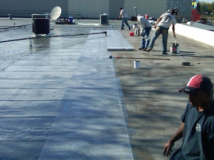 Polarhide Epoxy Roof-LAYING FABRIC into Polarhide Gray Base Coat